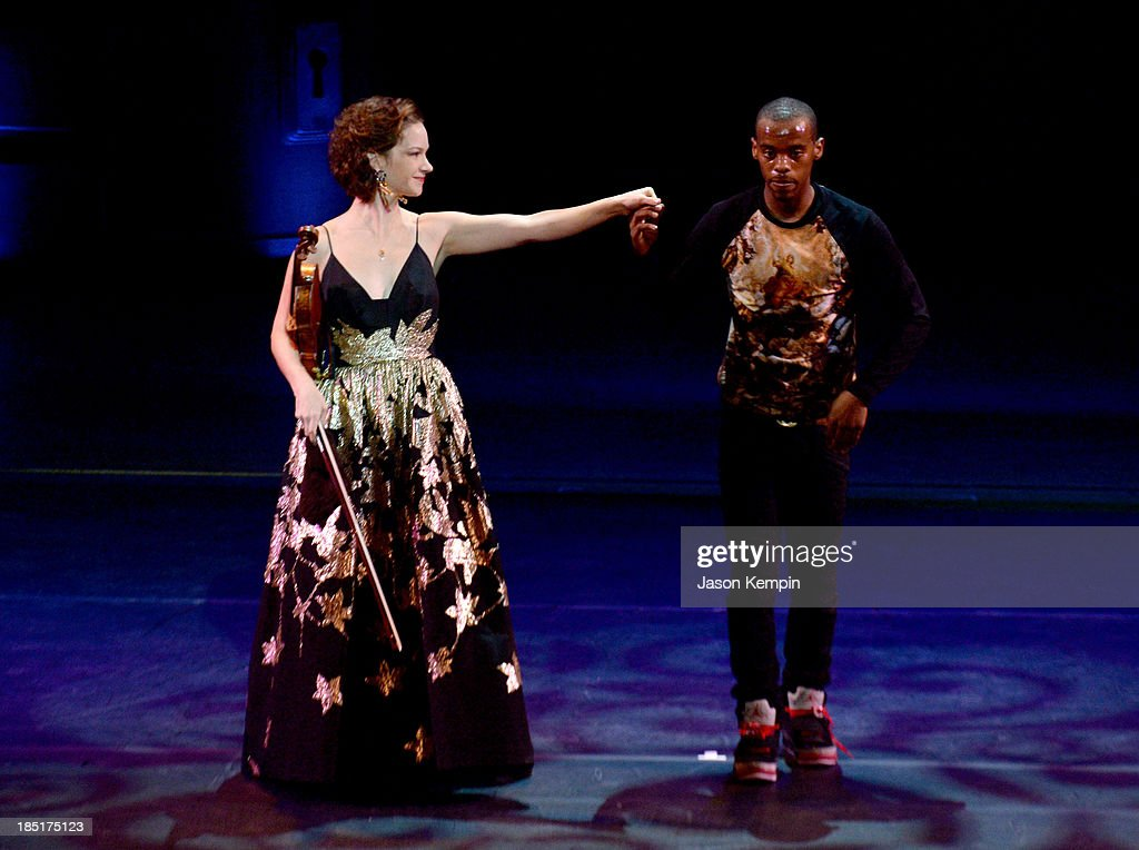 Violinist Hilary Hahn and dancer Lil Buck perform onstage during the Wallis Annenberg Center for the Performing Arts Inaugural Gala presented by Salvatore Ferragamo at the Wallis Annenberg Center for the Performing Arts on October 17, 2013 in Beverly Hills, California.