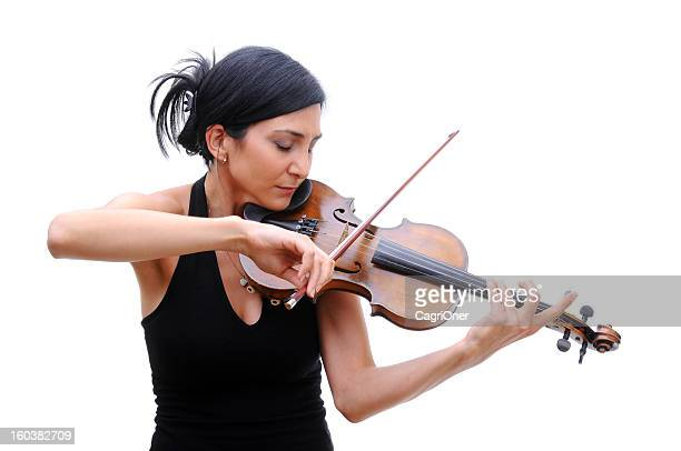 Violinist in black tee playing her violin with eyes closed