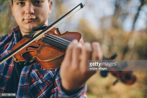 Violinist in nature