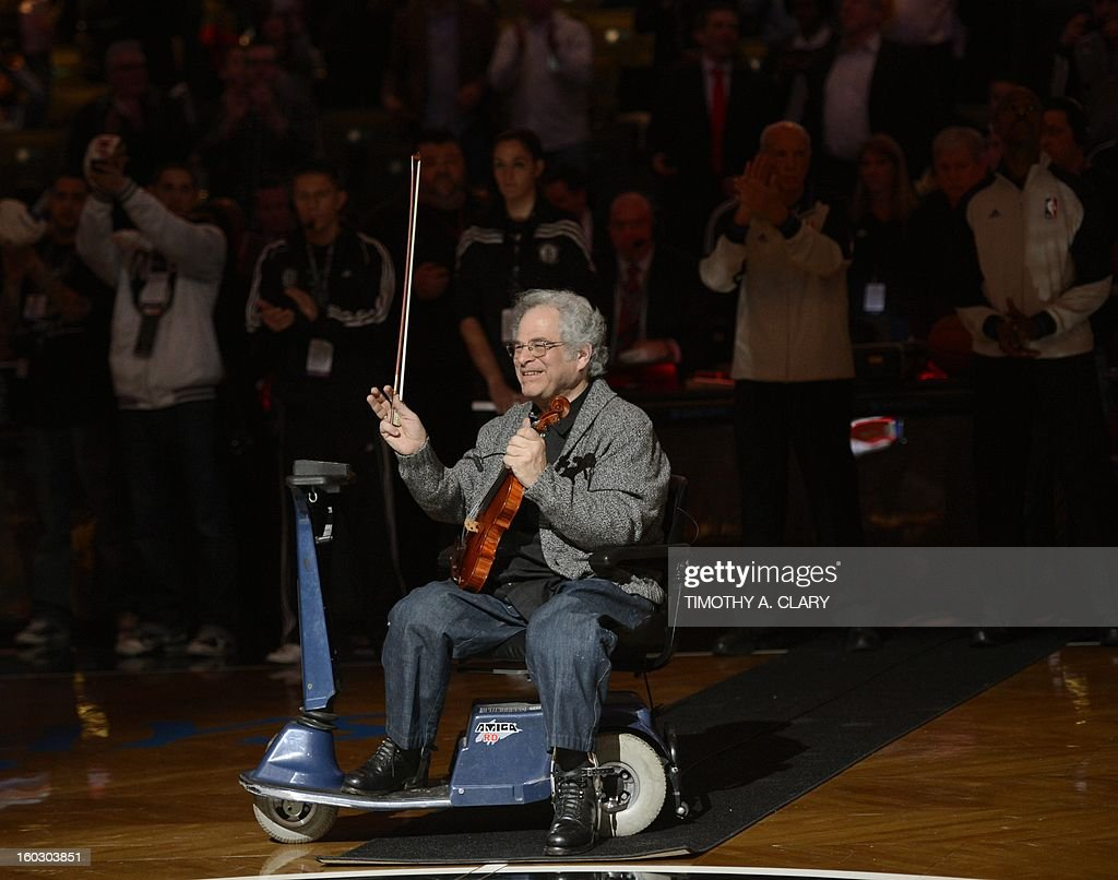 Violinist Itzhak Perlman performs before the NBA game between the Brooklyn Nets and Orlando Magic at the Barclays Center on January 28 , 2013 in the Brooklyn borough of New York City.