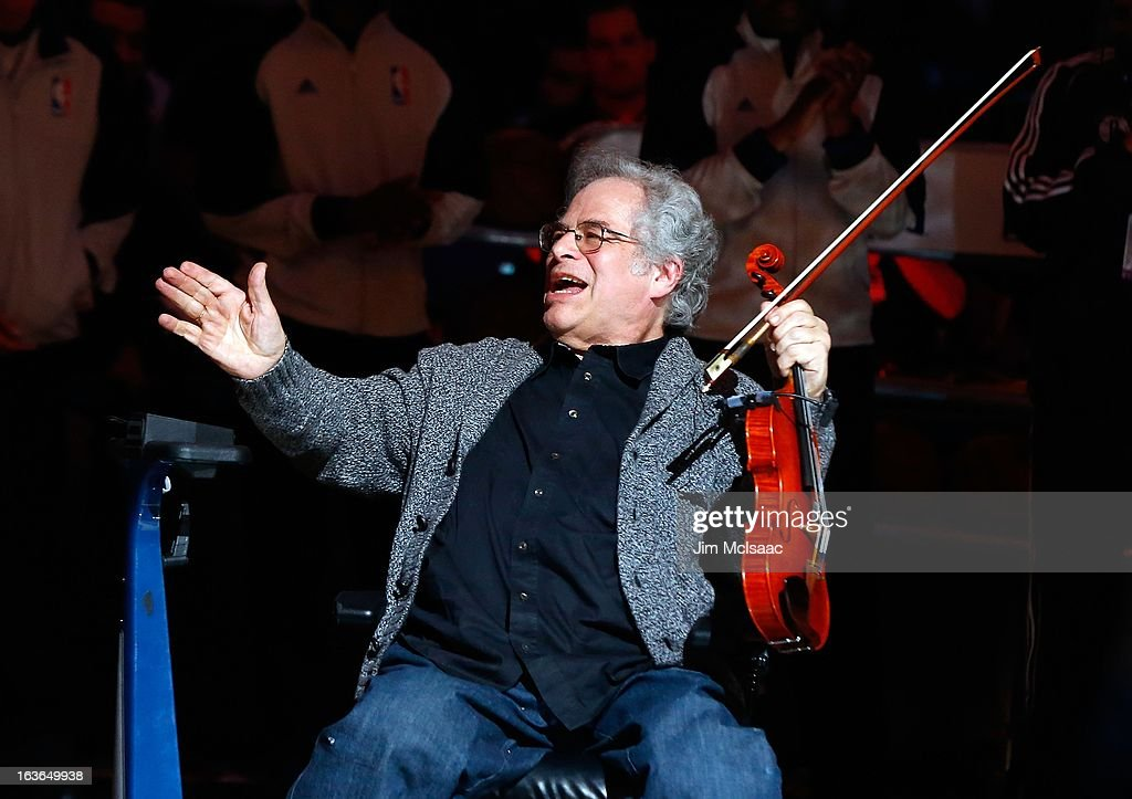 Violinist Itzhak Perlman performs before the NBA game between the Brooklyn Nets and Orlando Magic at the Barclays Center on January 28 , 2013 in the Brooklyn borough of New York City.The Nets defeated the Magic 97-77.