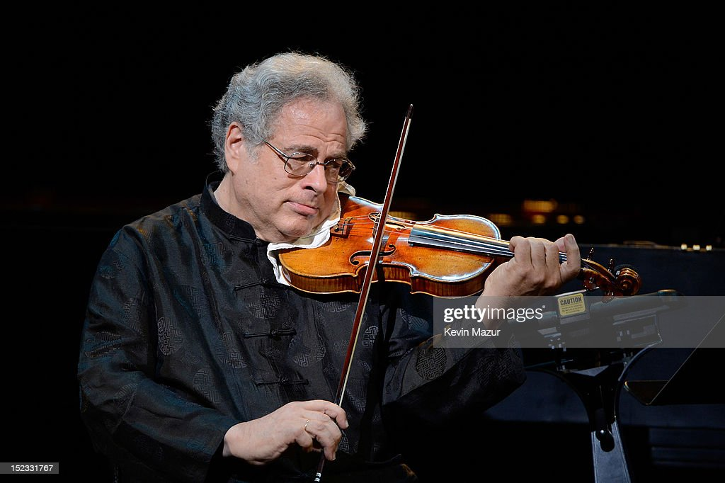 Violinist Itzhak Perlman performs 'I Cannot Hear the City' from Sweet Smell of Success on stage at the memorial of Marvin Hamlisch at Peter Jay Sharp Theater on September 18, 2012 in New York City.