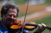 Violinist Itzhak Perlman performs the National Anthem before the Opening Day game betweent the Florida Marlins and New York Mets at Shea Stadium on...