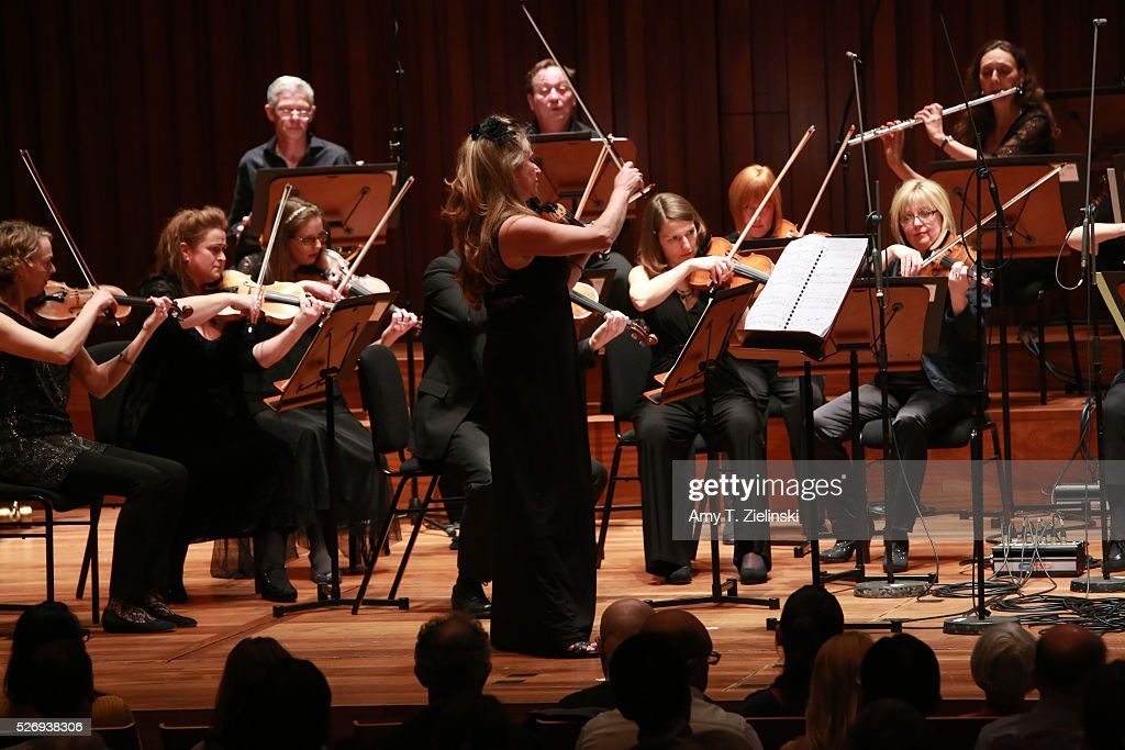 Violinist Jacqueline Shave plays while directing the Britten Sinfonia in a performance premiering in London new work by composer Elena Langer at Milton Court Concert Hall on May 1, 2016 in London, England.