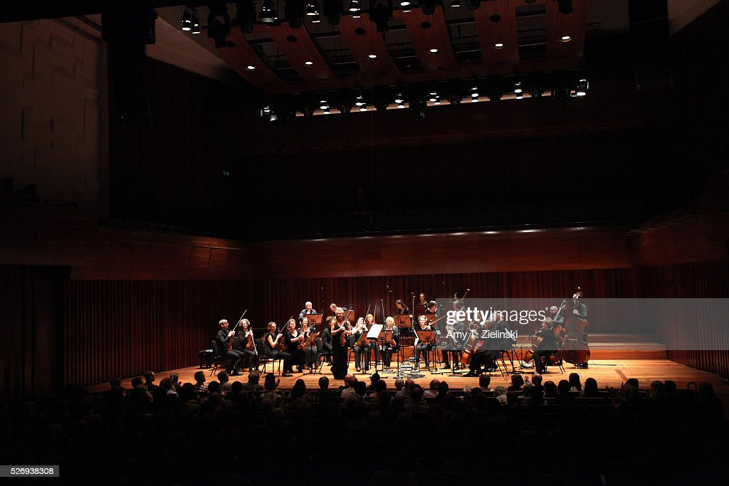 Violinist Jacqueline Shave receives the audience after playing while directing the Britten Sinfonia in a performance premiering in London new work by composer Elena Langer at Milton Court Concert Hall on May 1, 2016 in London, England.