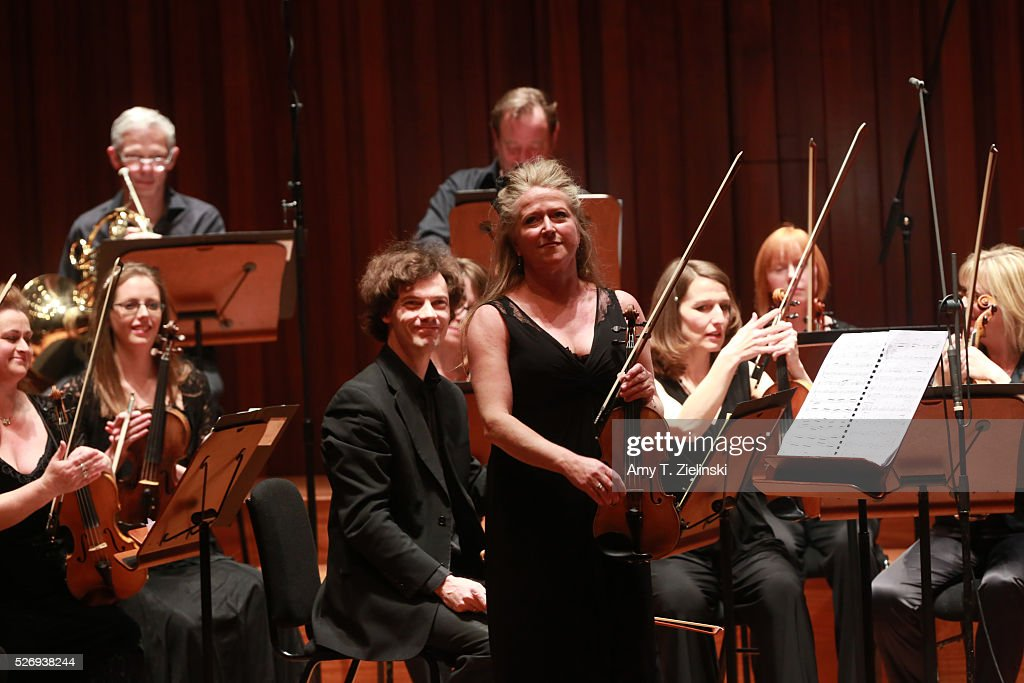 Violinist Jacqueline Shave receives the audience before playing while directing the Britten Sinfonia in a performance premiering in London new work by composer Elena Langer at Milton Court Concert Hall on May 1, 2016 in London, England.