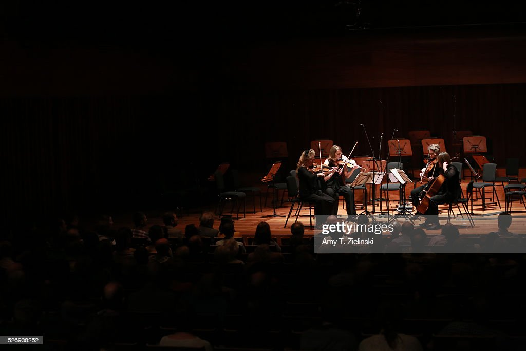 Violinist Jacqueline Shave with members of the Britten Sinfonia perform the Bartok String Quartet No 2 (2nd movement) at Milton Court Concert Hall on May 1, 2016 in London, England.