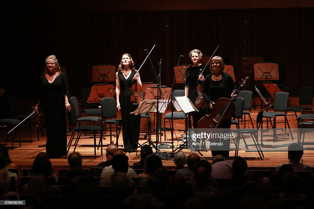 Violinist Jacqueline Shave with members of the Britten Sinfonia receive the audience before performing the Bartok String Quartet No 2 (2nd movement) at Milton Court Concert Hall on May 1, 2016 in London, England.