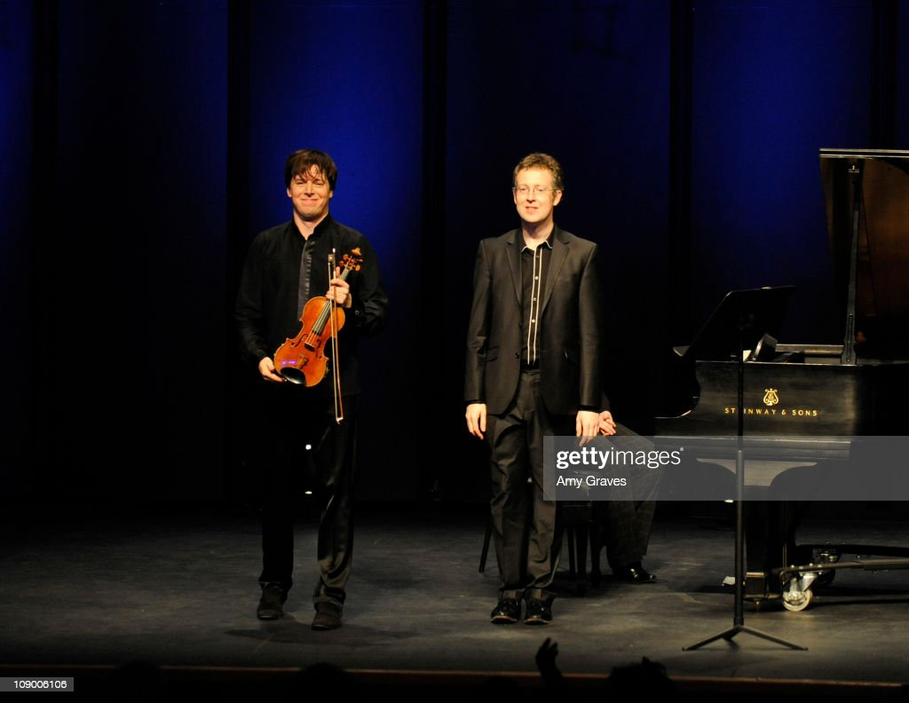 Violinist <a gi-track='captionPersonalityLinkClicked' href=/galleries/search?phrase=Joshua+Bell+-+Musician&family=editorial&specificpeople=556072 ng-click='$event.stopPropagation()'>Joshua Bell</a> and pianist Sam Haywood perform at The Broad Stage on February 10, 2011 in Santa Monica, California.