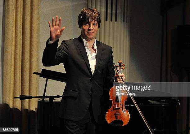 Violinist Joshua Bell performs at the Education Through Music's 8th annual Children's Benefit gala at The Waldorf Astoria on May 7 2009 in New York...