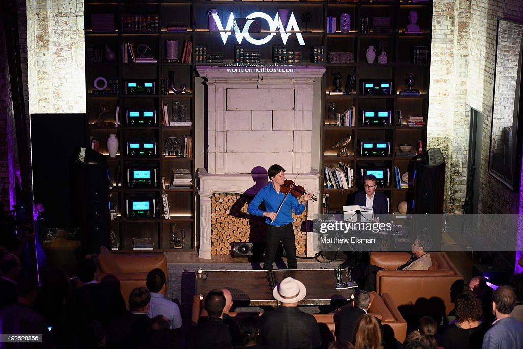 Violinist <a gi-track='captionPersonalityLinkClicked' href=/galleries/search?phrase=Joshua+Bell+-+Musician&family=editorial&specificpeople=556072 ng-click='$event.stopPropagation()'>Joshua Bell</a> performs at the WOM Townhouse Launch Event featuring Keith Haring artwork on October 13, 2015 in New York City.