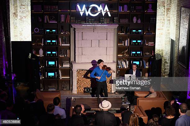Violinist Joshua Bell performs at the WOM Townhouse Launch Event featuring Keith Haring artwork on October 13 2015 in New York City
