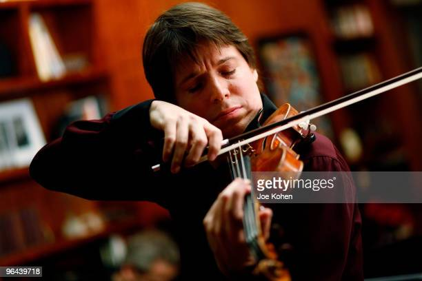 Violinist Joshua Bell performs during an event to celebrates Joshua Bell's 'At Home With Friends' album release at a Private Residence on January 25...