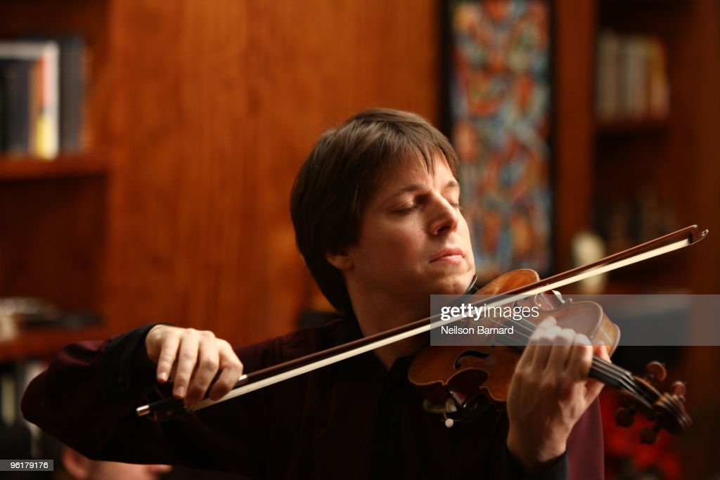 Violinist <a gi-track='captionPersonalityLinkClicked' href=/galleries/search?phrase=Joshua+Bell+-+Musician&family=editorial&specificpeople=556072 ng-click='$event.stopPropagation()'>Joshua Bell</a> performs in celebration of the album release of <a gi-track='captionPersonalityLinkClicked' href=/galleries/search?phrase=Joshua+Bell+-+Musician&family=editorial&specificpeople=556072 ng-click='$event.stopPropagation()'>Joshua Bell</a>'s 'At Home With Friends' and partnership with Music Unites and Education Through Music at a Private Residence on January 25, 2010 in New York City.
