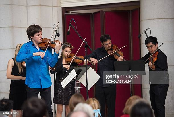 US violinist Joshua Bell performs with musicians from the National YoungArts Foundation at Union Station in Washington DC on September 30 2014 The...