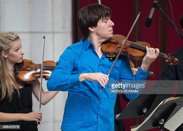 US violinist Joshua Bell performs with musicians from the National YoungArts Foundation at Union Station on September 30 2014 in WashingtonDC The...