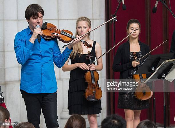 US violinist Joshua Bell speaks during a performance with musicians from the National YoungArts Foundation at Washington's Union Station on September...