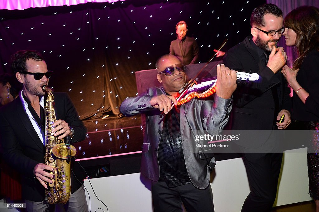 Violinist Julio Cuba, saxophonist Florencio Cruz and DJ Philippe Paris perform onstage MOCA's 35th Anniversary Gala presented by Louis Vuitton at The Geffen Contemporary at MOCA on March 29, 2014 in Los Angeles, California.