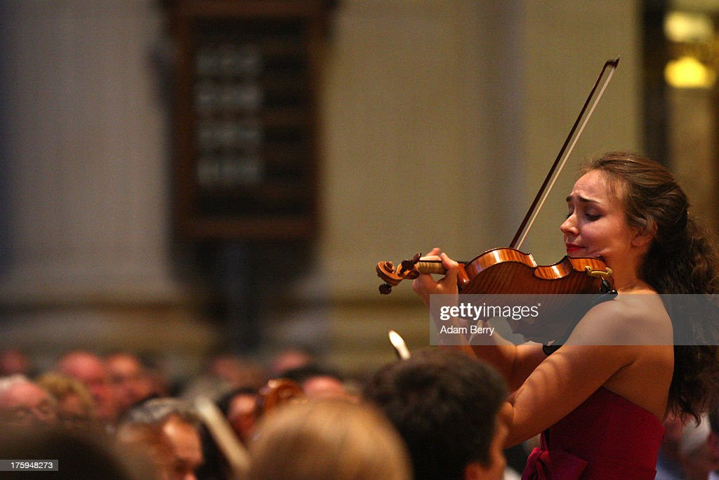 Violinist Ksenia Dubrovskaya performs with the Philharmonie der Nationen orchestra on its 'Sommersinfonie' tour in the Berliner Dom (Berlin Cathedral) on August 10, 2013 in Berlin, Germany. The orchestra was founded in 1995 and features musicians from forty countries, predominently Eastern European countries. In the Berliner Dom, they performed Mozart's Violin Concerto Nr. 3 in G Major and Bruckner's Symphony No. 3 in D Minor.