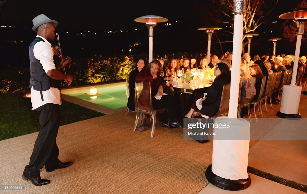 Violinist Lee England, Jr. performs at the Vacheron Constantin High Jewelry Collection Dinner at a private residence on October 10, 2013 in Los Angeles, California.