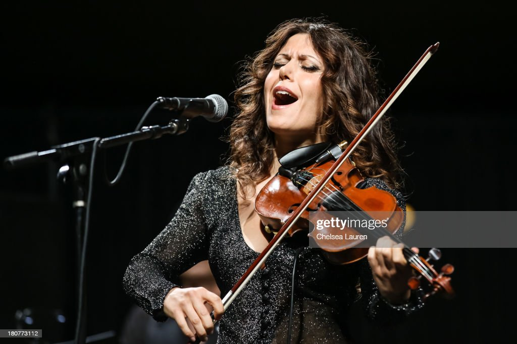 Violinist <a gi-track='captionPersonalityLinkClicked' href=/galleries/search?phrase=Lili+Haydn&family=editorial&specificpeople=839926 ng-click='$event.stopPropagation()'>Lili Haydn</a> performs at Adopt the Arts' Peace Through Music celebrity gala at Loews Hollywood Hotel on September 15, 2013 in Hollywood, California.