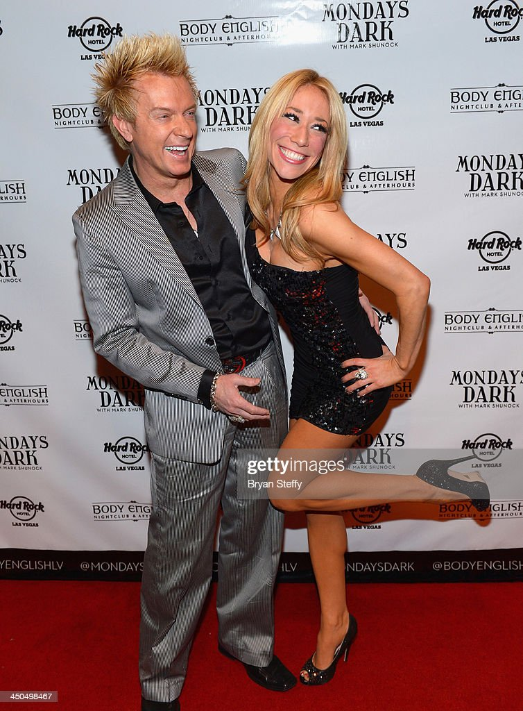 Violinist Lydia Ansel (L) and entertainer Chris Phillips of Zowie Bowie arrive at Mondays Dark with Mark Shunock charity event at the Body English Nightclub inside the Hard Rock Hotel & Casino on November 18, 2013 in Las Vegas, Nevada.