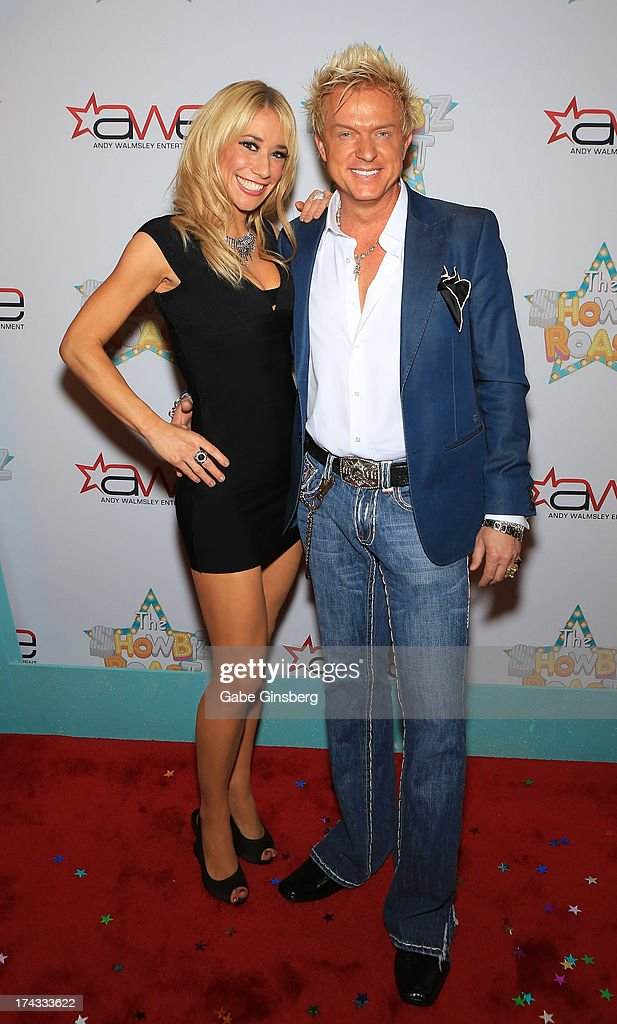 Violinist Lydia Ansel (L) and singer Chris Phillips of Zowie Bowie arrive at the 'Showbiz Roast of Oscar Goodman' at the Stratosphere Casino Hotel on July 23, 2013 in Las Vegas, Nevada.
