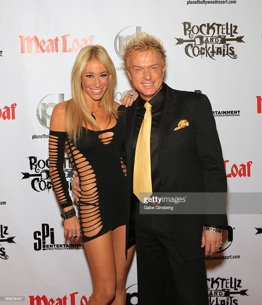 Violinist Lydia Ansel (L) and singer Chris Phillips of Zowie Bowie arrive at the show 'RockTellz & CockTails presents Meat Loaf' at Planet Hollywood Resort & Casino on October 3, 2013 in Las Vegas, Nevada.
