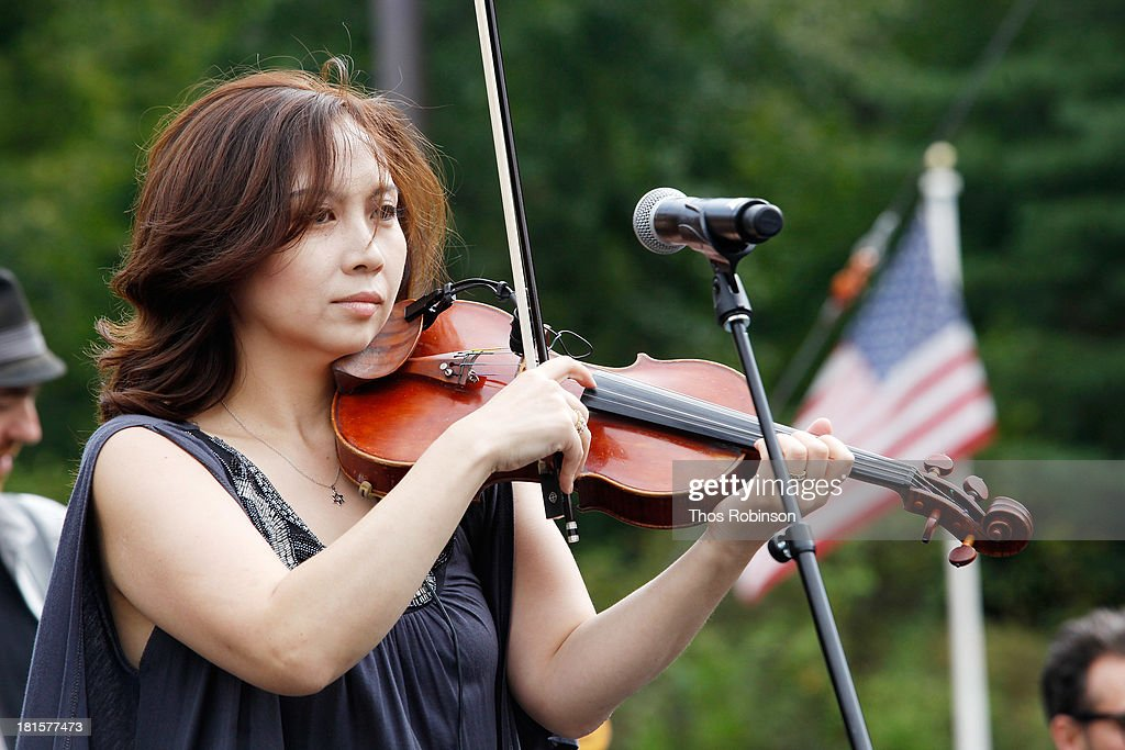 Violinist Meg Okura of Pharaoh's Daughter performs at the Shinnyo Lantern Floating For Peace event at Trump Rink at Central Park on September 22, 2013 in New York City.