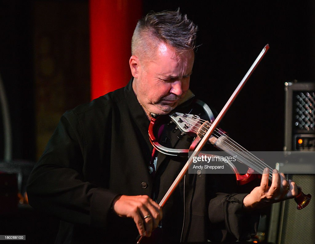 Violinist Nigel Kennedy performs on stage at Pizza Express Jazz Club on September 10, 2013 in London, England.