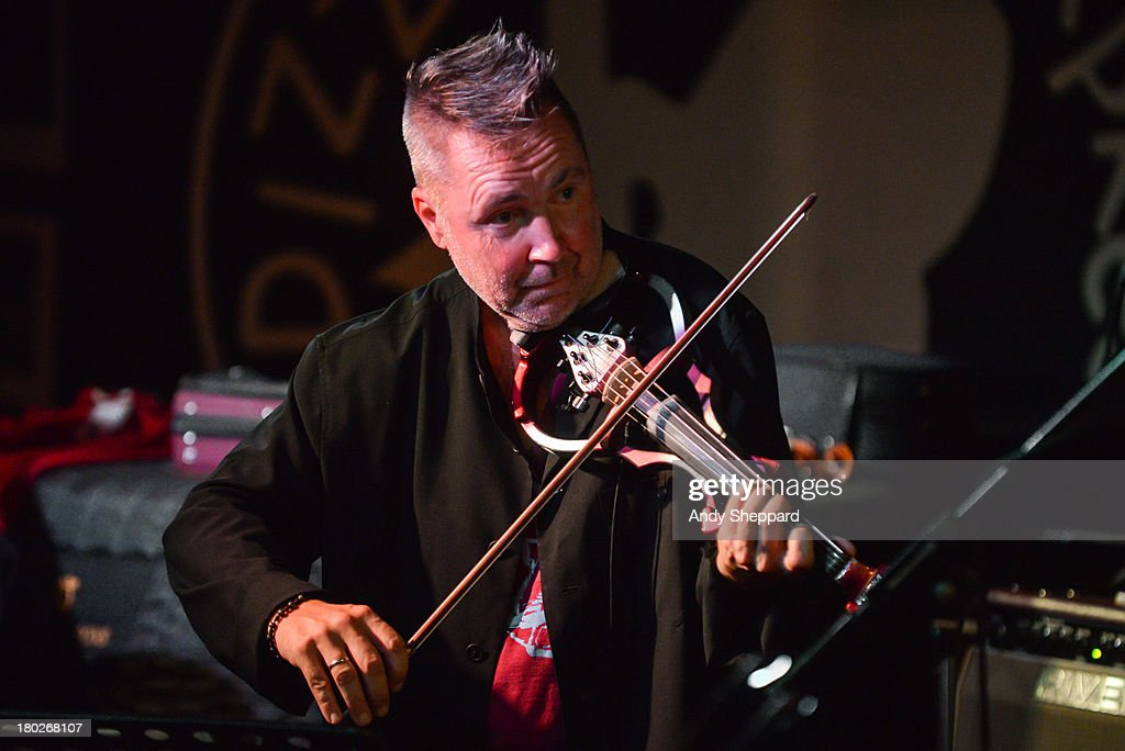 Violinist <a gi-track='captionPersonalityLinkClicked' href=/galleries/search?phrase=Nigel+Kennedy&family=editorial&specificpeople=991974 ng-click='$event.stopPropagation()'>Nigel Kennedy</a> performs on stage at Pizza Express Jazz Club on September 10, 2013 in London, England.