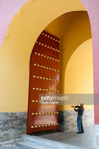 Violinist Playing in Front of Door at the Temple of Heaven