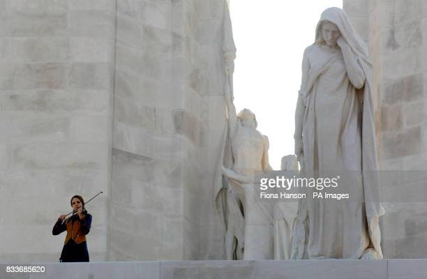 A violinist plays during a ceremony at the Vimy memorial near Lille in northern France