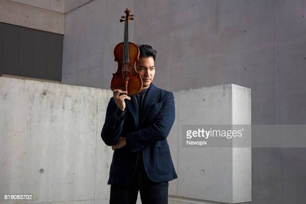BRISBANE QLD Violinist Ray Chen poses during a photo shoot in Brisbane Queensland