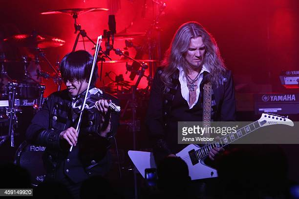 Violinist Roddy Chong and guitarist Joel Hoekstra of TransSiberian Orchestra perform onstage during an exclusive performance at The iHeartRadio...