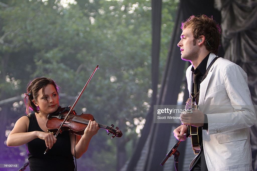 Violinist Sara Watkins and mandolinist Chris Thile of the band Nickel Creek performs live at Rumsey Playfield in Central Park August 14, 2007 in New York City.