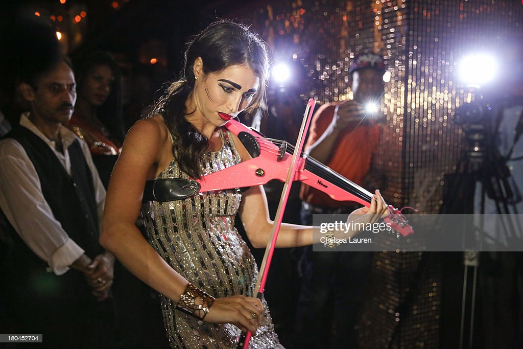 Violinist Sarah Charness performs at the Indashio fashion show during Mercedes-Benz Fashion Week Spring 2014 at EVR NYC on September 12, 2013 in New York City.