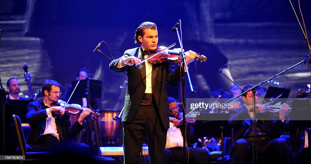 Violinist Virgil Lupu and American Hollywood Film Orchestra perform on the stage during Chongqing New Year Concert at Chongqing Grand Theatre on December 27, 2012 in Chongqing, China.