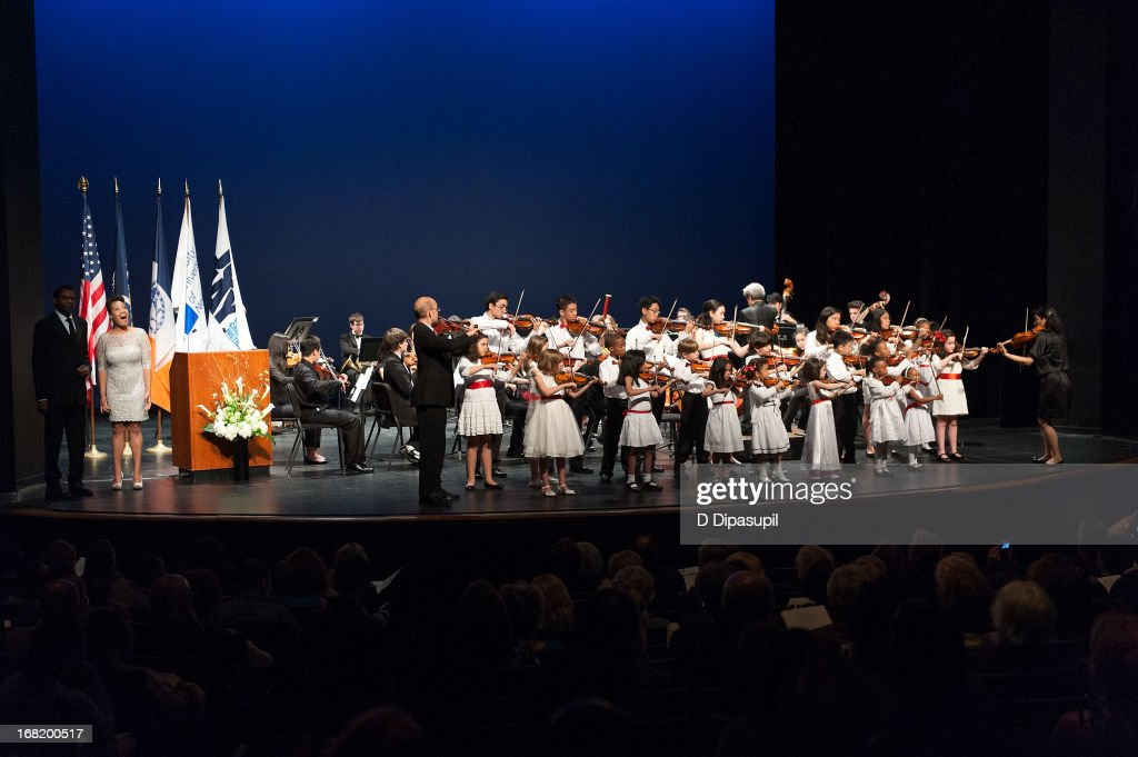 Violinists from the Mozart Academy, Queens College, and Manhattan, Diller Quaile, and Bloomingdale schools of music perform on stage during the Newtown Memorial Concert at Gerald W. Lynch Theatre on May 6, 2013 in New York City.