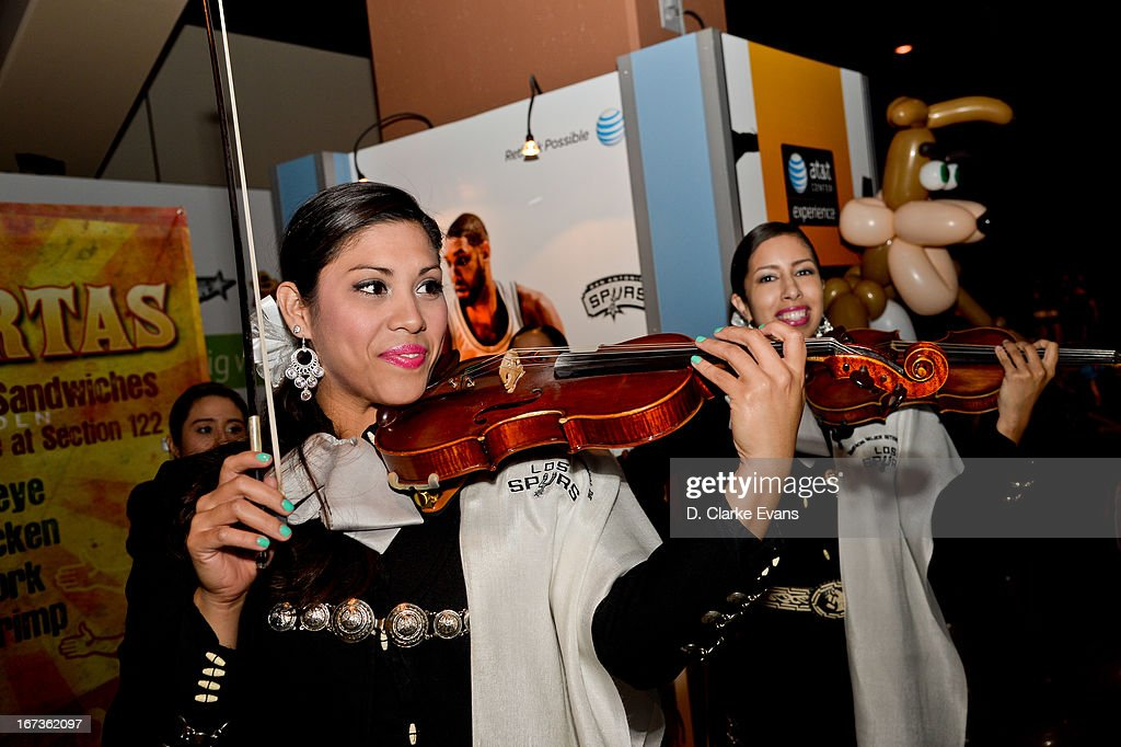 Violinists perform as fans arrive to watch the Los Angeles Lakers play the San Antonio Spurs in Game Two of the Western Conference Quarterfinals during the 2013 NBA Playoffs on April 24, 2013 at the AT&T Center in San Antonio, Texas.