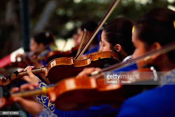 Violinists Performing at Earth Day Celebration