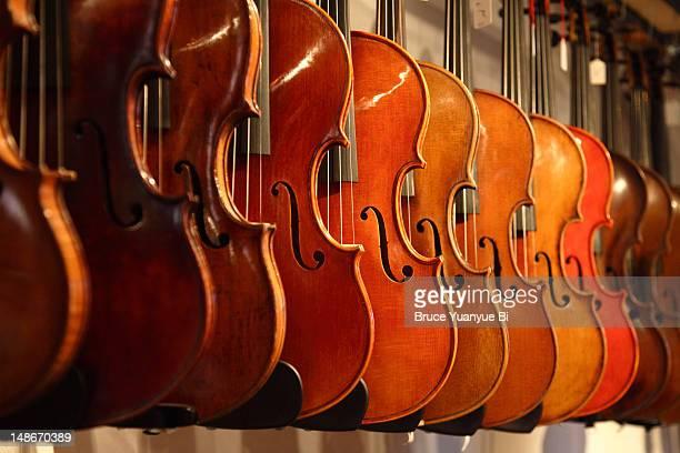 Violins ready for sale in workshop of Pierre Chaubert.