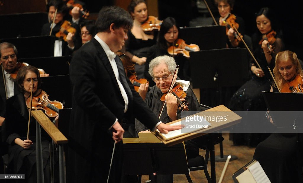 Violinst <a gi-track='captionPersonalityLinkClicked' href=/galleries/search?phrase=Itzhak+Perlman&family=editorial&specificpeople=593397 ng-click='$event.stopPropagation()'>Itzhak Perlman</a> and music director Alan Gilbert perform at the New York Philharmonic 2012-2013 Opening Gala at Avery Fisher Hall at Lincoln Center for the Performing Arts on September 27, 2012 in New York City.
