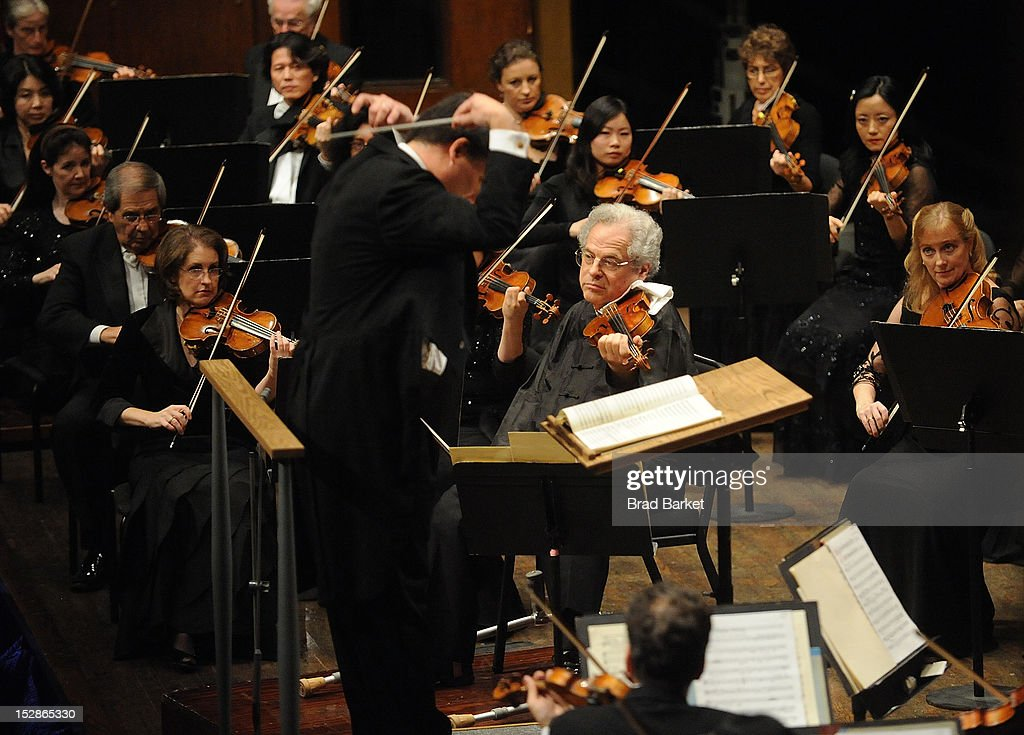 Violinst Itzhak Perlman and music director Alan Gilbert perform at the New York Philharmonic 2012-2013 Opening Gala at Avery Fisher Hall at Lincoln Center for the Performing Arts on September 27, 2012 in New York City.