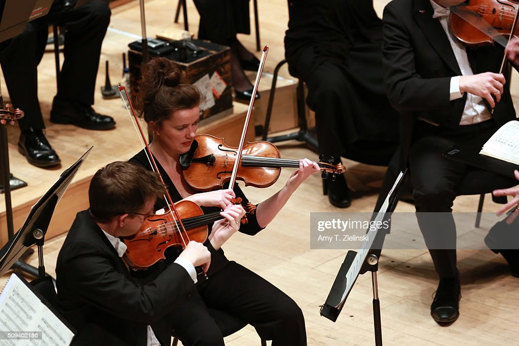 Violists play as English pianist Stephen Hough performs at the piano as Finnish conductor Osmo Vanska leads the London Philharmonic Orchestra in composer Antonin Dvorak's Piano Concerto in G minor in the Southbank Centre's the Royal Festival Hall on February 10, 2016 in London, England.