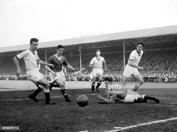 Viollet the Manchester United insideleft breaks through the Bournemouth and Boscombe defence but with goalkeeper Godwin on the ground and well beaten...