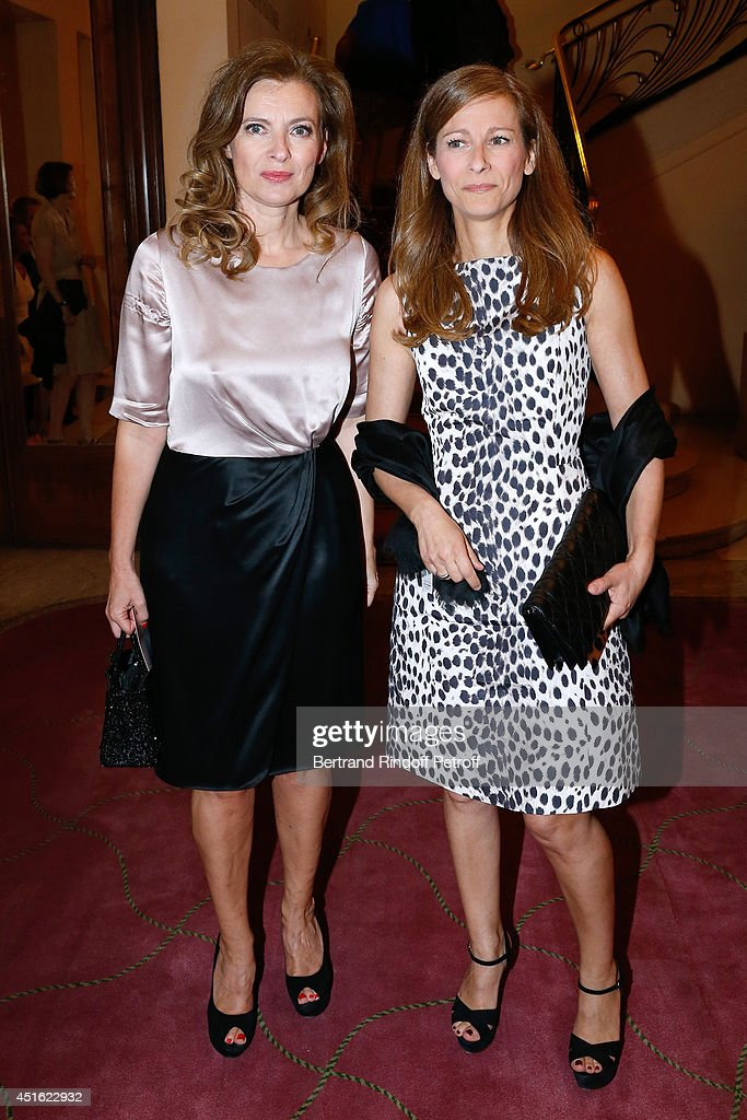 Violonist Anne Gravoin and journalist Valerie Trierweiler attend the '20th Amnesty International France' : Gala at Theatre des Champs-Elysees on July 2, 2014 in Paris, France.