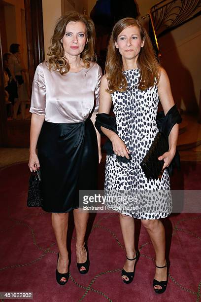 Violonist Anne Gravoin and journalist Valerie Trierweiler attend the '20th Amnesty International France' Gala at Theatre des ChampsElysees on July 2...