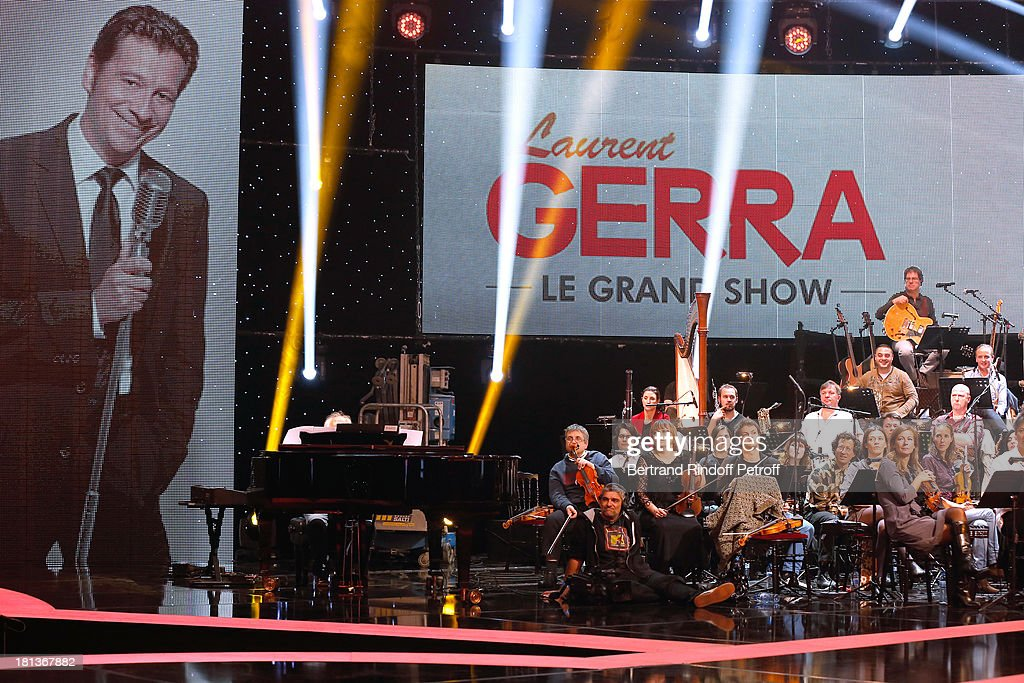 Violonist Anne Gravoin (3rd R, blond hair) and orchestra perform at 'Le Grand Show' by Laurent Gerra : Rehearsal at La Plaine Saint Denis on September 20, 2013 in Paris, France.