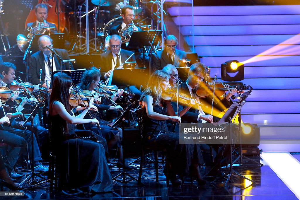 Violonist Anne Gravoin (1st R blond hair) and orchestra perform at 'Le Grand Show' by Laurent Gerra : Rehearsal at La Plaine Saint Denis on September 20, 2013 in Paris, France.
